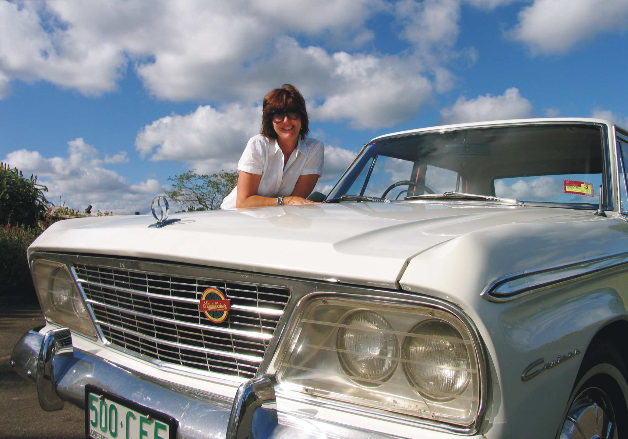 Gail with her currently owned 1966 Studebaker Cruiser